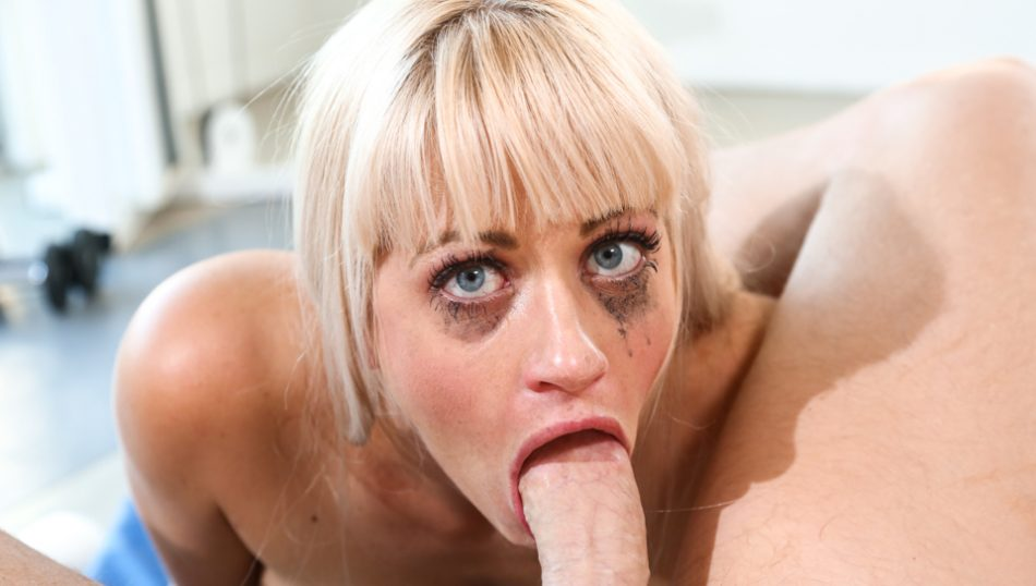 Throated Slutty Holly gags while deep throating on a hard cock.