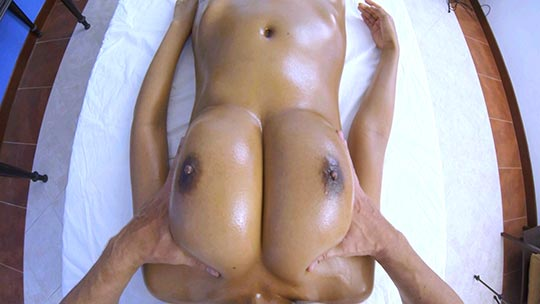 Watch the lucky masseur massage the massive titties on this beautiful Thai girl