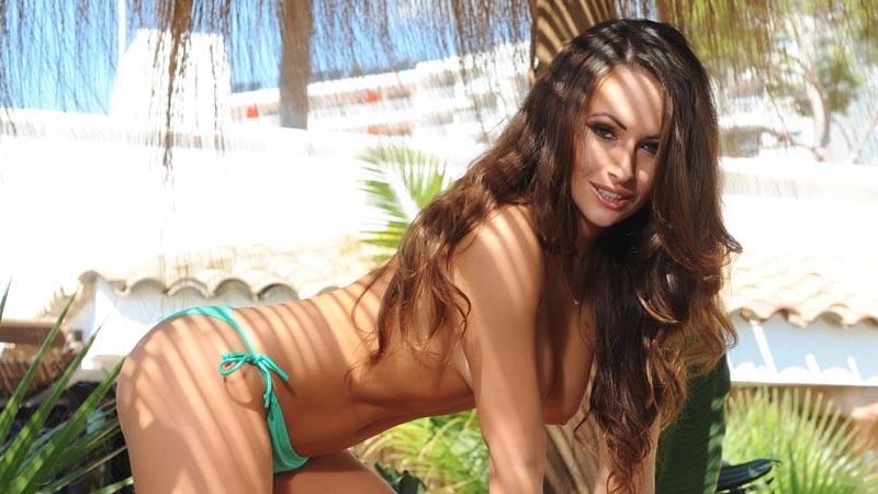 Anastasia strips out of her green bikini.
