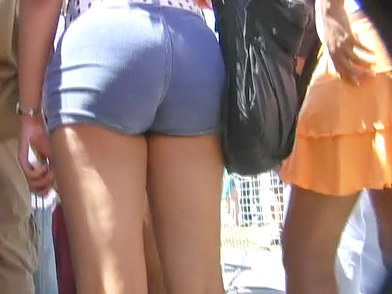 The delicious ass shorts underlining the beauty of young butt cheeks moving underneath